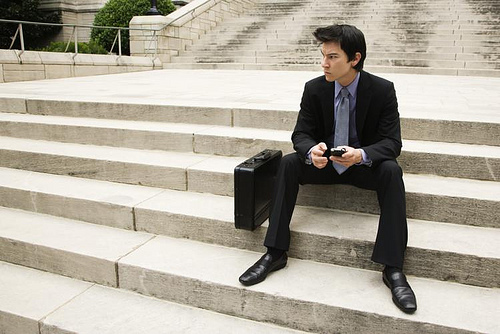 businessman sitting on steps