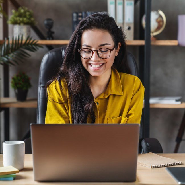 Woman satisfied with managing compensation planning with Payscale